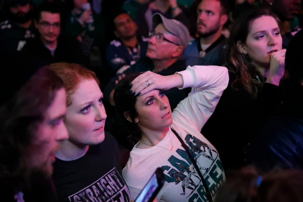 . People react during the second half of the NFL Super Bowl 52 between the Philadelphia Eagles and the New England Patriots, Sunday, Feb. 4, 2018, in Philadelphia. (AP Photo/Matt Rourke)