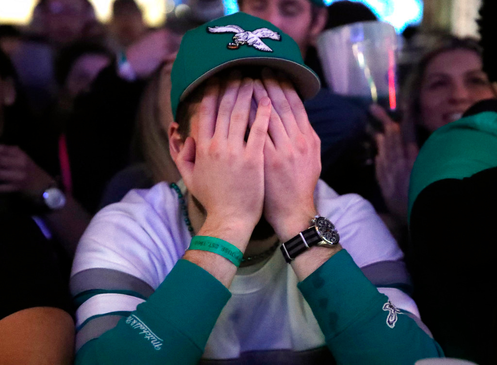 . A person reacts during Super Bowl 52 between the Philadelphia Eagles and the New England Patriots, Sunday, Feb. 4, 2018, in Philadelphia. (AP Photo/Matt Rourke)