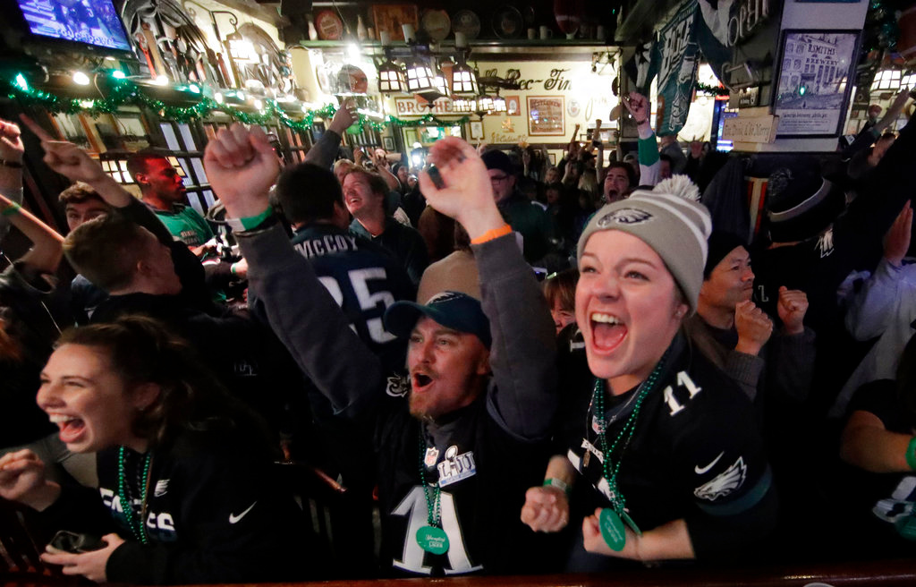 . Philadelphia Eagles fans react in Philadelphia while watching the first half of the NFL Super Bowl 52 football game between the Eagles and the New England Patriots in Minneapolis, Sunday, Feb. 4, 2018. (AP Photo/Matt Rourke)