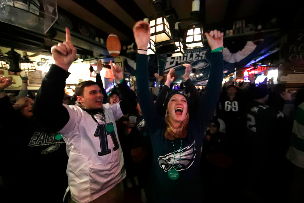 . People react during Super Bowl 52 between the Philadelphia Eagles and the New England Patriots, Sunday, Feb. 4, 2018, in Philadelphia. (AP Photo/Matt Rourke)