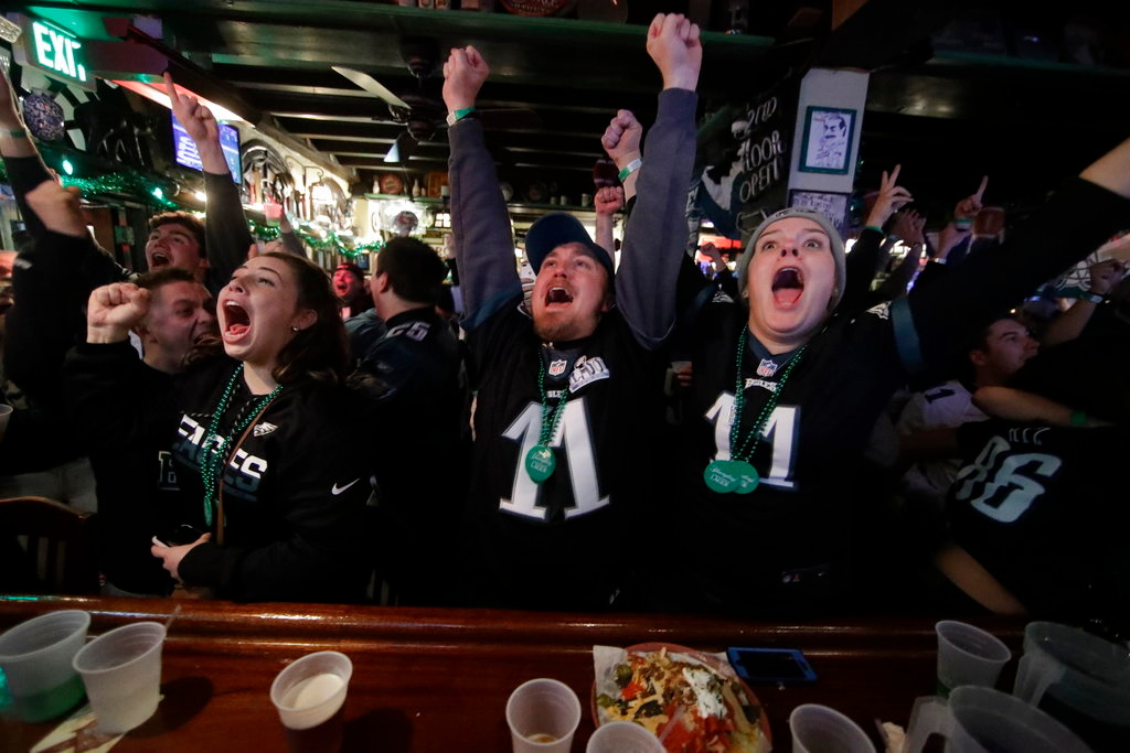 . Eagles fans react during the first half of Super Bowl 52 between the Philadelphia Eagles and the New England Patriots, Sunday, Feb. 4, 2018, in Philadelphia. (AP Photo/Matt Rourke)