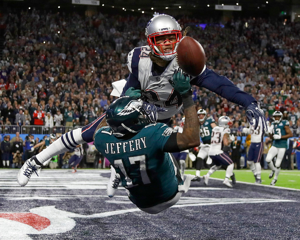. New England Patriots\' Stephon Gilmore, top, breaks up a pass intended for Philadelphia Eagles\' Alshon Jeffery during the first half of the NFL Super Bowl 52 football game Sunday, Feb. 4, 2018, in Minneapolis. (AP Photo/Matt Slocum)