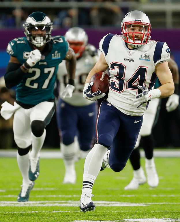 . New England Patriots running back Rex Burkhead (34), runs during the first half of the NFL Super Bowl 52 football game against the New England Patriots, Sunday, Feb. 4, 2018, in Minneapolis. (AP Photo/Charlie Neibergall)