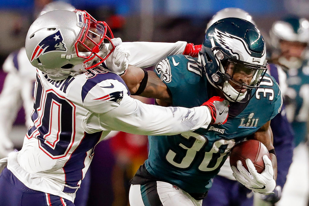. Philadelphia Eagles running back Corey Clement (30), right, runs against New England Patriots strong safety Duron Harmon (30), during the first half of the NFL Super Bowl 52 football game, Sunday, Feb. 4, 2018, in Minneapolis. (AP Photo/Tony Gutierrez)