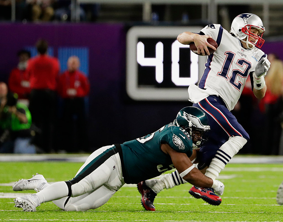 . Philadelphia Eagles defensive end Brandon Graham (55) tackles New England Patriots quarterback Tom Brady (12), during the first half of the NFL Super Bowl 52 football game, Sunday, Feb. 4, 2018, in Minneapolis. (AP Photo/Frank Franklin II)