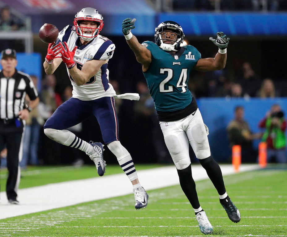 . Philadelphia Eagles defensive back Corey Graham (24) breaks up a pass intended for New England Patriots wide receiver Chris Hogan (15), during the second half of the NFL Super Bowl 52 football game Sunday, Feb. 4, 2018, in Minneapolis. (AP Photo/Tony Gutierrez)