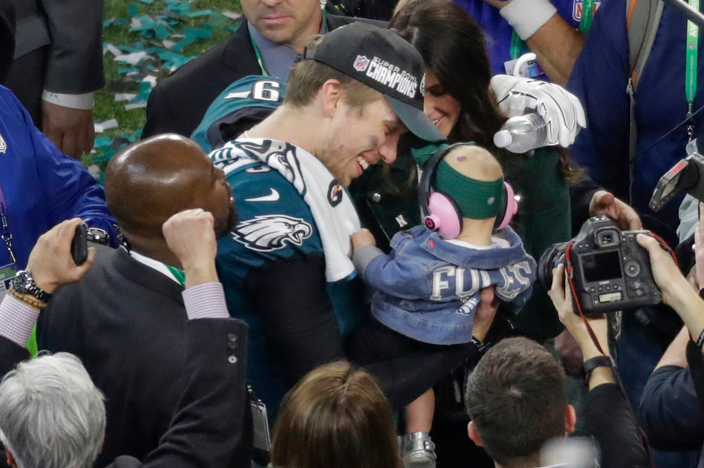 . Philadelphia Eagles quarterback Nick Foles celebrates with his daughter, Lily, and wife, Tori, after the NFL Super Bowl 52 football game against the New England Patriots, Sunday, Feb. 4, 2018, in Minneapolis. The Eagles won 41-33. (AP Photo/Eric Gay)