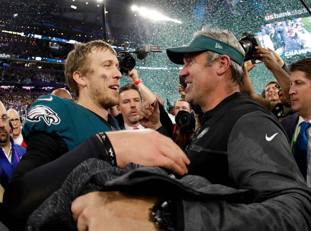 . Philadelphia Eagles\' Nick Foles, left, celebrates with head coach Doug Pederson after the NFL Super Bowl 52 football game against the New England Patriots Sunday, Feb. 4, 2018, in Minneapolis. The Eagles won 41-33. (AP Photo/Matt Slocum)
