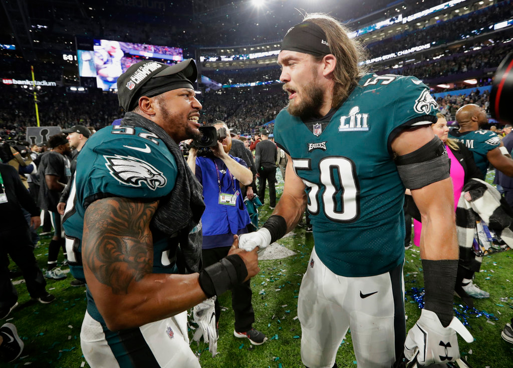 . Philadelphia Eagles outside linebacker Najee Goode (52) and defensive end Bryan Braman (50), celebrate after the NFL Super Bowl 52 football game against the New England Patriots Sunday, Feb. 4, 2018, in Minneapolis. The Eagles won 41-33. (AP Photo/Frank Franklin II)