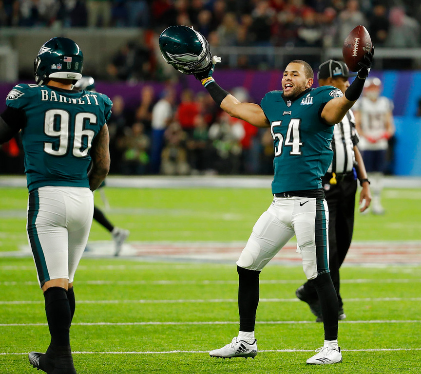 . Philadelphia Eagles\' Kamu Grugier-Hill and Derek Barnett celebrate during the second half of the NFL Super Bowl 52 football game against the New England Patriots Sunday, Feb. 4, 2018, in Minneapolis. (AP Photo/Charlie Neibergall)