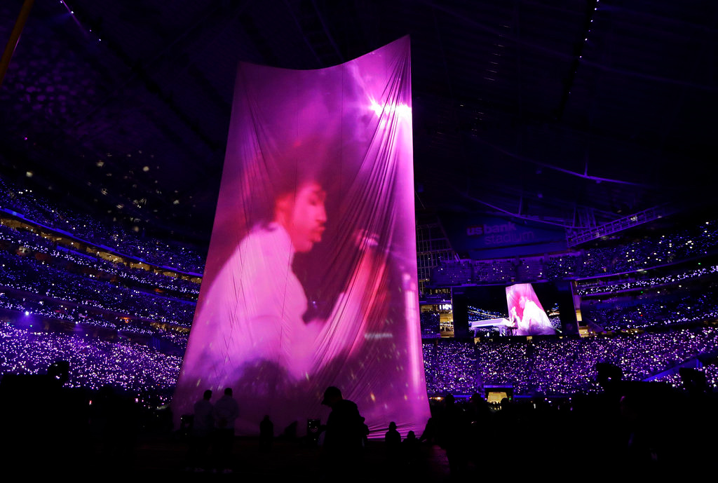 . A large image of Prince is shown as Justin Timberlake performs during halftime of the NFL Super Bowl 52 football game between the Philadelphia Eagles and the New England Patriots Sunday, Feb. 4, 2018, in Minneapolis. (AP Photo/Mark Humphrey)