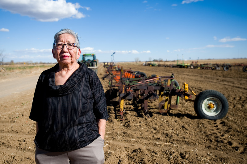 "Charlotte Tanaka stands in front of farming equipment that will be sold in an auction in November at Tanaka Farms in Longmont. Charlotte is closing the family farming business after her husband passed away this summer. <br /> More photos:  <a href=""http://www.dailycamera.com"">http://www.dailycamera.com</a><br /> (Autumn Parry/Staff Photographer)<br /> October 29, 2016"