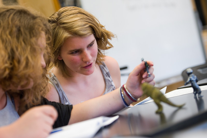 "Violet Byrnes, 13, and Tilly Yeats, 13, talk about the toy figures that they will use as inspiration to help them highlight quotes in their writing during an exercise at 'Tell Your Story,' a summer program that incorporates writing, performance and art, at CU Boulder on Wednesday.<br /> More photos:  <a href=""http://www.dailycamera.com"">http://www.dailycamera.com</a><br /> (Autumn Parry/Staff Photographer)<br /> June 29, 2016"