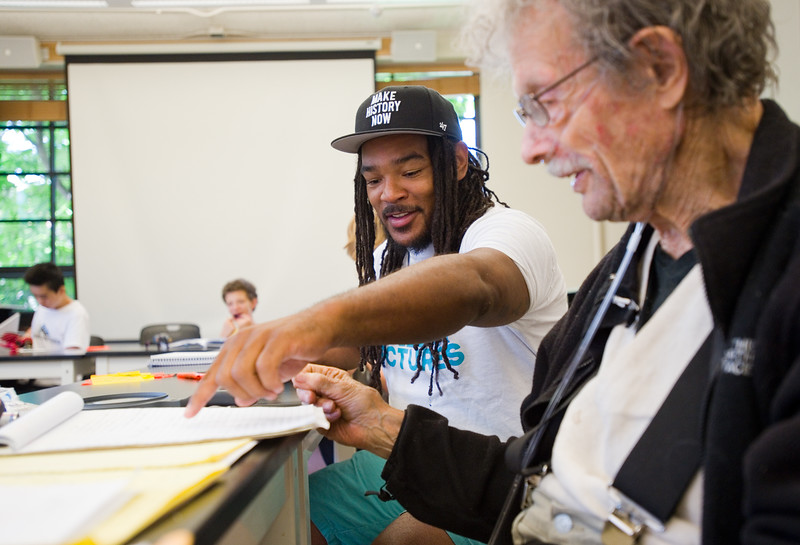 "Instructor Jovan Mays reviews a writing exercise with Jack Collom, during 'Tell Your Story,' a summer program that incorporates writing, performance and art, at CU Boulder on Wednesday.<br /> More photos:  <a href=""http://www.dailycamera.com"">http://www.dailycamera.com</a><br /> (Autumn Parry/Staff Photographer)<br /> June 29, 2016"