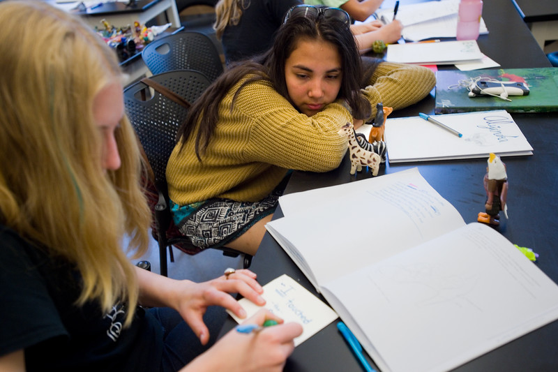 "Alejandra Floripe, 14, (right) and Annika Ekrem, 15, participate in a writing exercise during 'Tell Your Story,' a summer program that incorporates writing, performance and art, at CU Boulder on Wednesday.<br /> More photos:  <a href=""http://www.dailycamera.com"">http://www.dailycamera.com</a><br /> (Autumn Parry/Staff Photographer)<br /> June 29, 2016"
