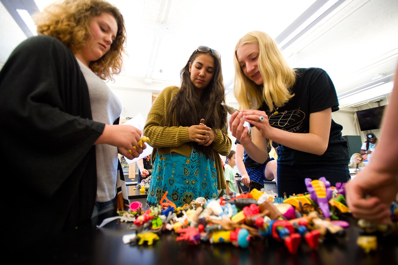 "From left to right, Violet Byrnes, 13, Alejandra Floripe, 14, and Annika Ekrem, 15, pick out toy figures as part of an exercise during 'Tell Your Story,' a summer program that incorporates writing, performance and art, at CU Boulder on Wednesday.<br /> More photos:  <a href=""http://www.dailycamera.com"">http://www.dailycamera.com</a><br /> (Autumn Parry/Staff Photographer)<br /> June 29, 2016"