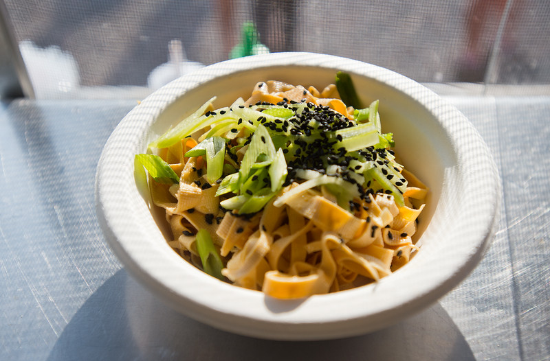 """Cold Chinese tofu noodle salad with hand cut local Colorado Sun tofu sheets, ginger and  green onions, tossed in house-made sesame oil dressing, is served by The Ginger Pig food truck at the new Rayback Collective food truck court in Boulder on Thursday. <br /> More photos:  <a href=""""http://www.dailycamera.com"""">http://www.dailycamera.com</a><br /> (Autumn Parry/Staff Photographer)<br /> July 28, 2016"""