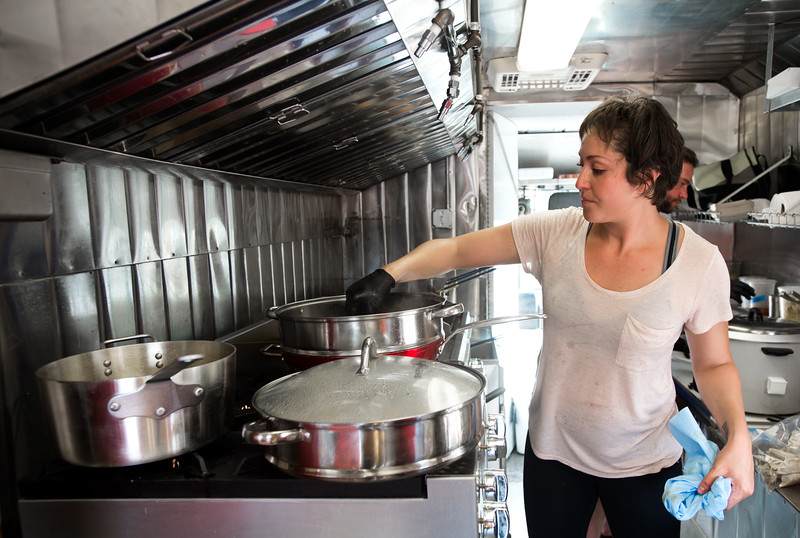 """Nahla Aljinabi, the sous chef, cooks meals for customers in The Ginger Pig food truck at the new Rayback Collective food truck court in Boulder on Thursday. <br /> More photos:  <a href=""""http://www.dailycamera.com"""">http://www.dailycamera.com</a><br /> (Autumn Parry/Staff Photographer)<br /> July 28, 2016"""