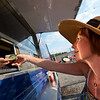 "Dawn Jones pays for the meal she ordered from The Ginger Pig food truck at the new Rayback Collective food truck court in Boulder on Thursday. <br /> More photos:  <a href=""http://www.dailycamera.com"">http://www.dailycamera.com</a><br /> (Autumn Parry/Staff Photographer)<br /> July 28, 2016"