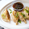 "Pork and ginger potstickers, made with local ground pork, seasonal vegetables and daikon is served with soy ginger dipping sauce by The Ginger Food Truck at Rayback Collective in Boulder on Thursday. <br /> More photos:  <a href=""http://www.dailycamera.com"">http://www.dailycamera.com</a><br /> (Autumn Parry/Staff Photographer)<br /> July 28, 2016"