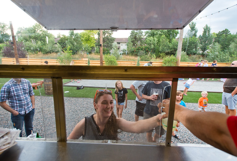 """Natascha Hess hands Caitlin Guerrie the lemonade she ordered at The Ginger Pig food truck at the new Rayback Collective food truck court in Boulder on Thursday. <br /> More photos:  <a href=""""http://www.dailycamera.com"""">http://www.dailycamera.com</a><br /> (Autumn Parry/Staff Photographer)<br /> July 28, 2016"""