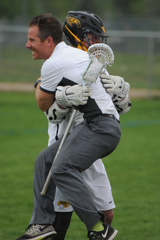 . Thompson Valley coach Will Cantwell hugs Jaydon Arnold after an Eagles\' goal during a 4A state quarterfinal game on Friday, May 11, 2018 at Patterson Stadium. (Sean Star/Loveland Reporter-Herald)