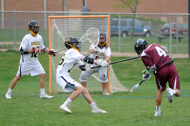 Cheyenne Mountain's Mark Reynolds (4) fires a ball past Thompson Valley goalie Corbin Shilling during a 4A state quarterfinal game on Friday, May 11, 2018 at Patterson Stadium. (Sean Star/Loveland Reporter-Herald)