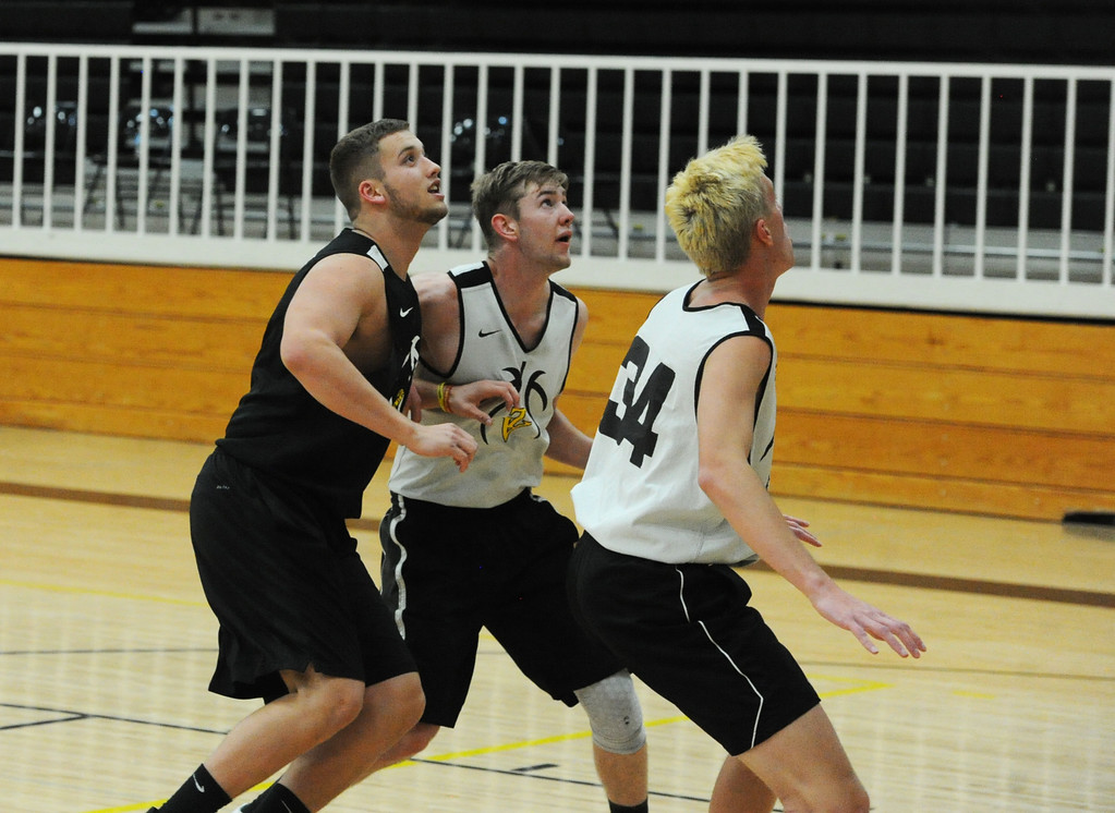 . From left, Thompson Valley\'s Joey Shaffer, Paul Pomerleau and Jacob Brouwer battle for rebound positioning during a recent practice at TVHS.