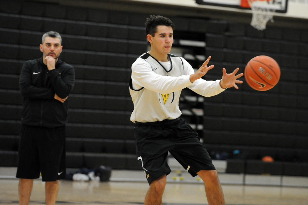 . Thompson Valley\'s Adrian Juarez makes a pass during a recent practice at TVHS.