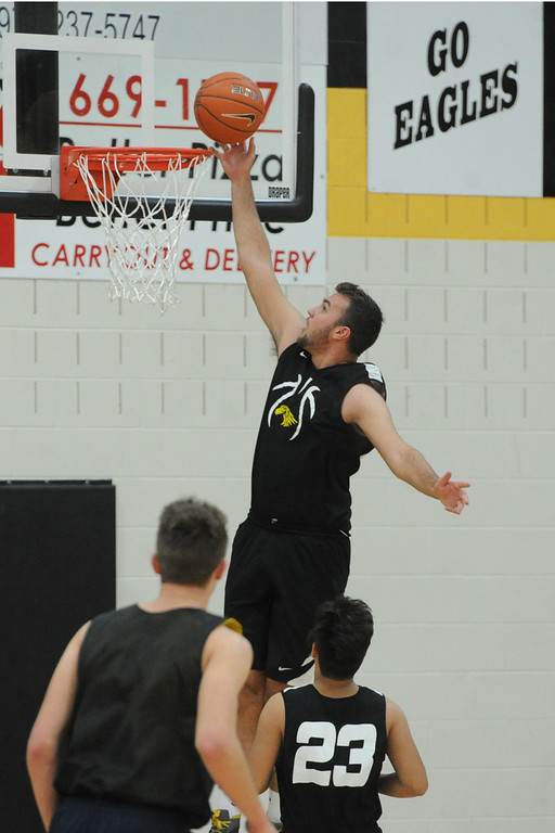 . Thompson Valley\'s Jared Kasprzak goes up for a layup during a recent practice at TVHS.