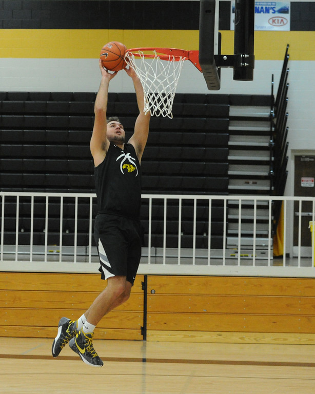 . Thompson Valley senior Jared Kasprzak goes up for an alley-oop during a recent practice at TVHS.