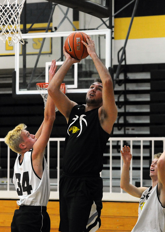 . Thompson Valley\'s Jared Kasprzak goes up for a layup next to Jacob Brouwer (34) during a recent practice at TVHS.