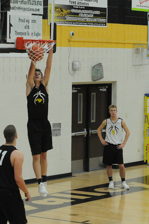 . Thompson Valley\'s Justin Wiersema goes up for an alley-oop during a recent practice at TVHS.