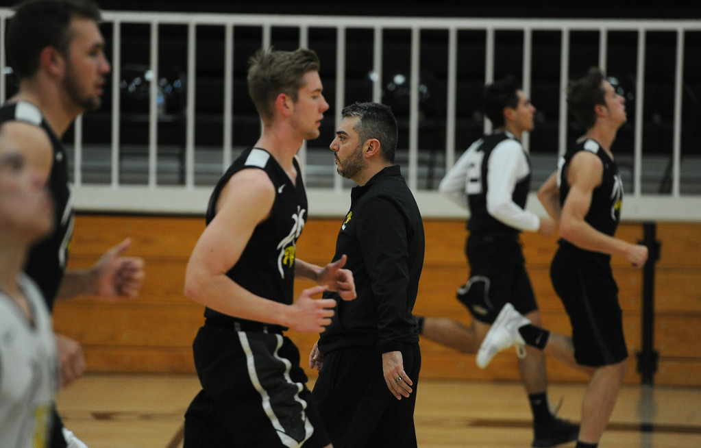 . Thompson Valley boys basketball coach Joe Johnson, middle, watches as his team warm up for a recent practice at TVHS.