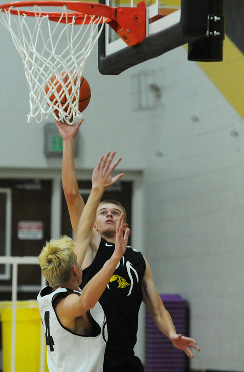 . Thompson Valley\'s Darren Edwards goes up for a layup against the defense of teammate Hayden Ell (34) during a recent practice at TVHS.