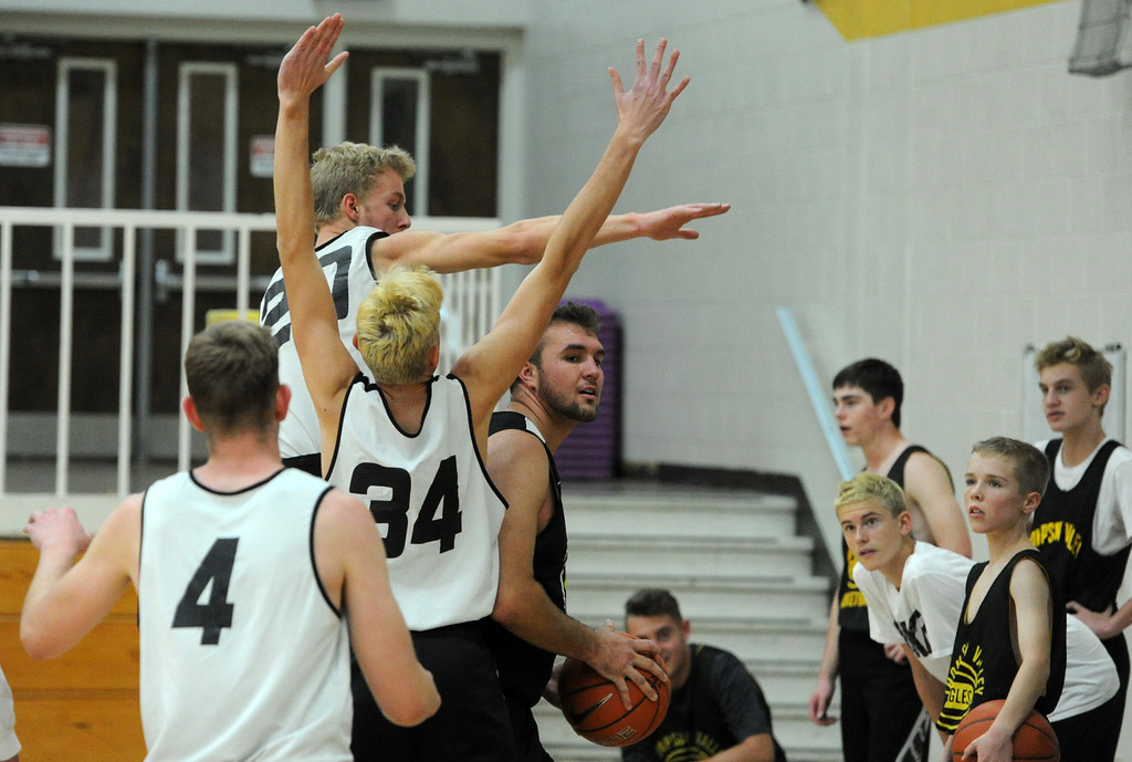 . Thompson Valley\'s Jared Kasprzak is surrounded by three defenders during a recent practice at TVHS.