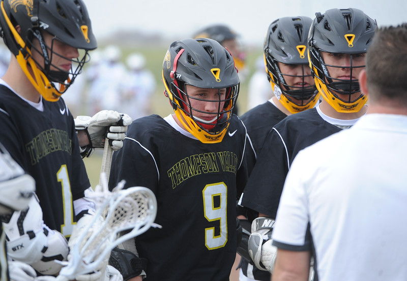 Thompson Valley's Andrew Dexter listens during a timeout during a game on Thursday, April 19, 2018 at Dawson School in Lafayette, Colorado. (Sean Star/Loveland Reporter-Herald)