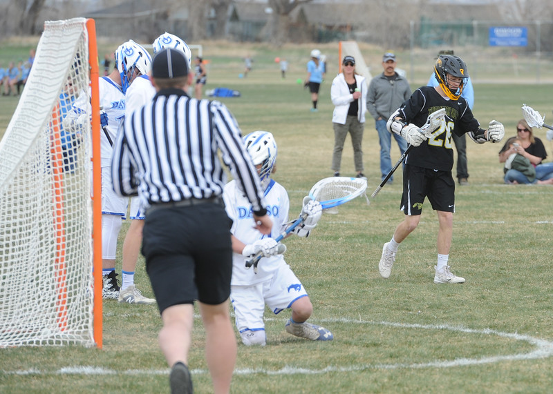 Thompson Valley's Greg Bilek, right, scores one of his seven goals during a game on Thursday, April 19, 2018 at Dawson School in Lafayette, Colorado. (Sean Star/Loveland Reporter-Herald)