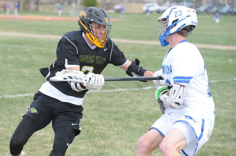Thompson Valley's Riley Kinney defends Dawson's Jackson Keener during a game on Thursday, April 19, 2018 at Dawson School in Lafayette, Colorado. (Sean Star/Loveland Reporter-Herald)