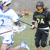 Thompson Valley's Trey Cardenas (24) chases down Dawson's Gavyn Pure during their game Thursday, April 19, 2018 in Lafayette, Colorado. (Sean Star/Loveland Reporter-Herald)