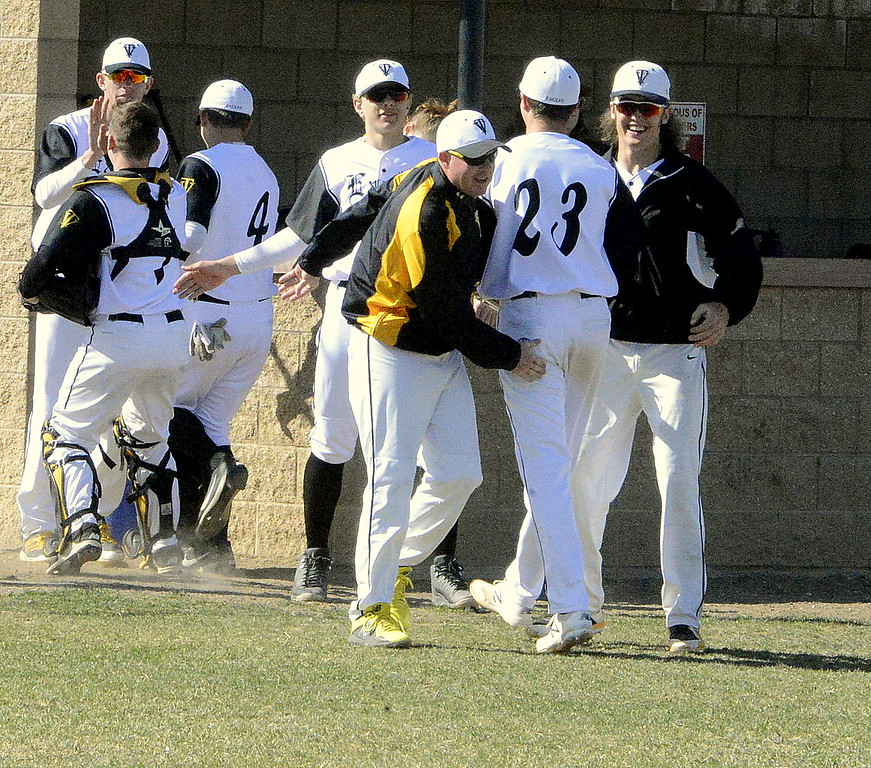 . Thompson Valley coach Jay Denning congratulates starting pitcher Aiden Schultz on a 1-2-3 first inning in Monday\'s matchup with Mountain View. There were few clean innings on the day. (Mike Brohard/Loveland Reporter-Herald)
