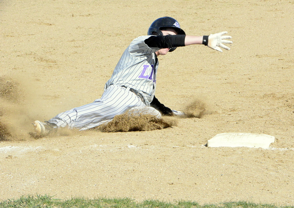 . Mountain View\'s Shane Shadowen slides into third during Monday\'s game with Thompson Valley at Contantz Field. (Mike Brohard/Loveland Reporter-Herald)