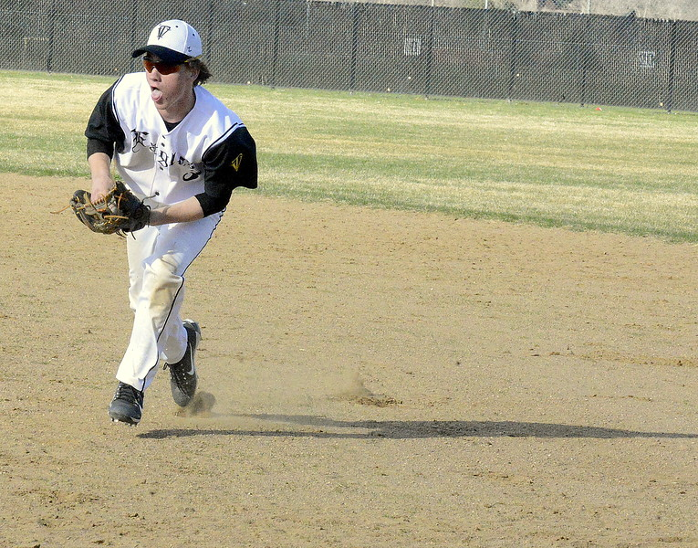 Thompson Valley second baseman Jarrett Riehl comes in to field a grounder that slid past first baseman Jayden Raabe in Monday's game with Mountain View at Constantz Field. Riehl got the out at first in the Eagles' 16-7 victory. (Mike Brohard/Loveland Reporter-Herald)