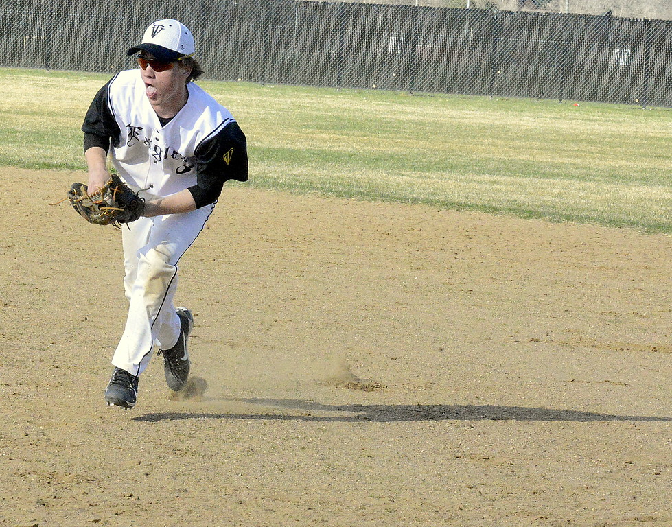 . Thompson Valley second baseman Jarrett Riehl comes in to field a grounder that slid past first baseman Jayden Raabe in Monday\'s game with Mountain View at Constantz Field. Riehl got the out at first in the Eagles\' 16-7 victory. (Mike Brohard/Loveland Reporter-Herald)