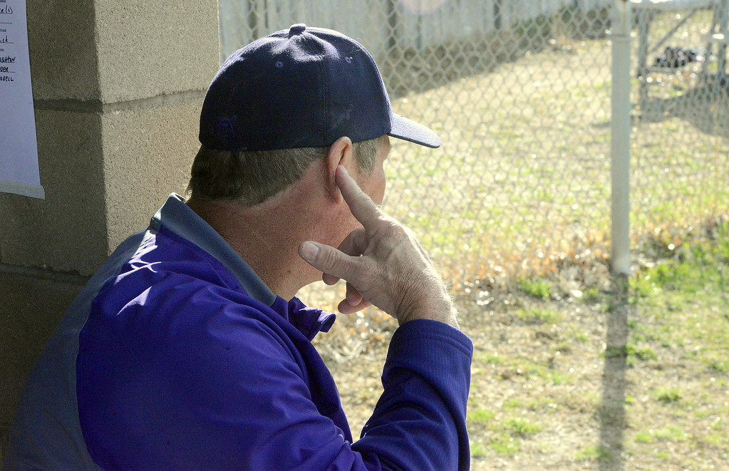 . Mountain View pitching coach Brad Moore flashes in signs to catcher Mike Felton during Monday\'s game with Thompson Valley at Constantz Field. The Eagles won 16-7. (Mike Brohard/Loveland Reporter-Herald)