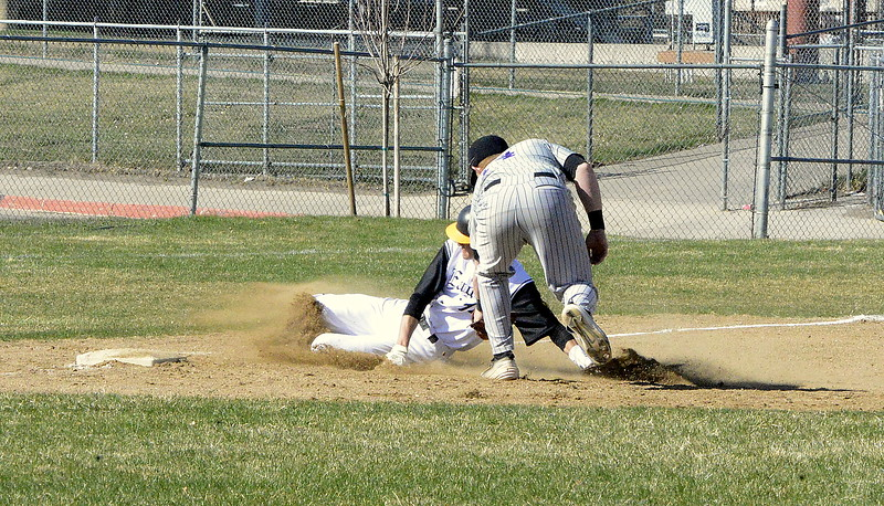 Mountain View third baseman Braden Barker puts the tag on Thompson Valley's Jayden Raabe, who was trying to advance and extra base in Monday's game at Constantz Field. (Mike Brohard/Loveland Reporter-Herald)