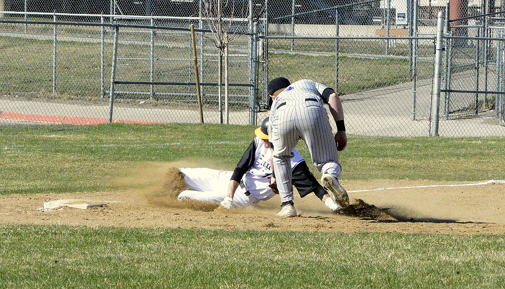. Mountain View third baseman Braden Barker puts the tag on Thompson Valley\'s Jayden Raabe, who was trying to advance and extra base in Monday\'s game at Constantz Field. (Mike Brohard/Loveland Reporter-Herald)