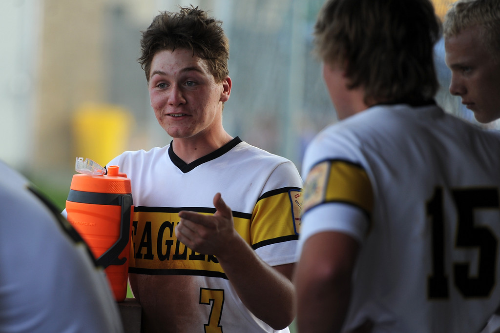 . Trenten Riehl talks with some teammates during Thompson Valley�s game Thursday, July 19, 2018 at Constantz Field in Loveland. (Sean Star/Loveland Reporter-Herald)