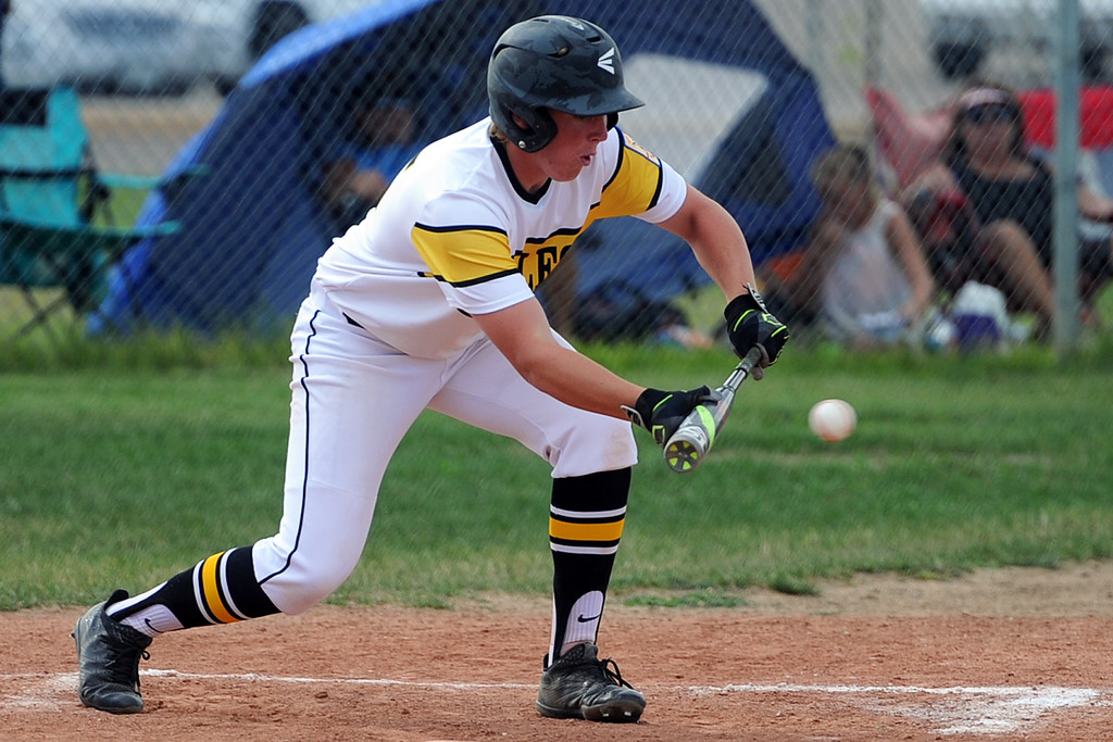 . James Dyken lays down a bunt during Thompson Valley�s game Thursday, July 19, 2018 at Constantz Field in Loveland. (Sean Star/Loveland Reporter-Herald)