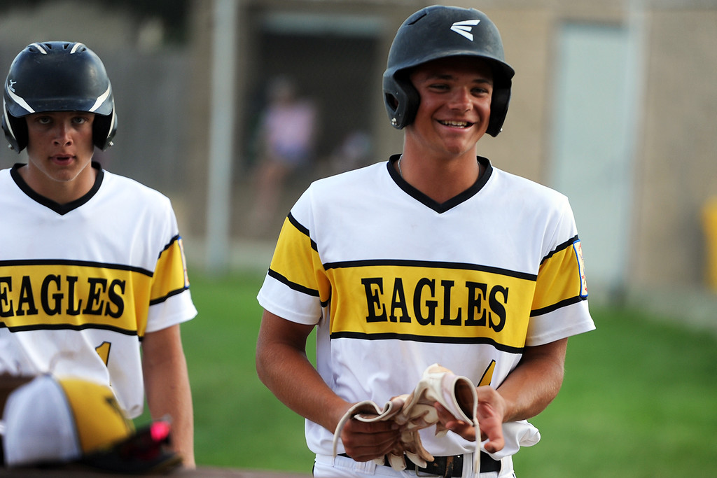 . Cameron Nellor, right, is all smiles as he enters the dugout ahead of his brother, Brock, during Thompson Valley�s game Thursday, July 19, 2018 at Constantz Field in Loveland. (Sean Star/Loveland Reporter-Herald)